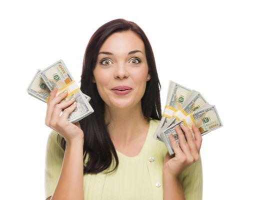 woman-holding-money-hundred-bills_large